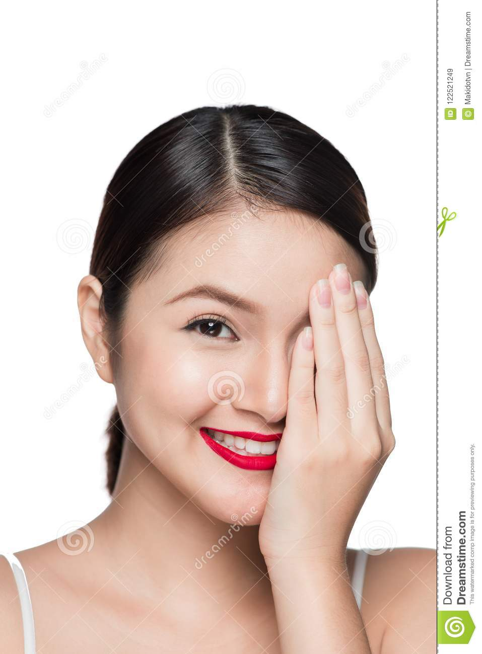 Beautiful asian woman with retro makeup with red lips isolated o