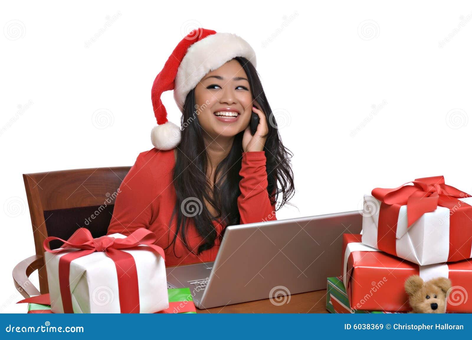 Beautiful Asian woman shops online for Christmas