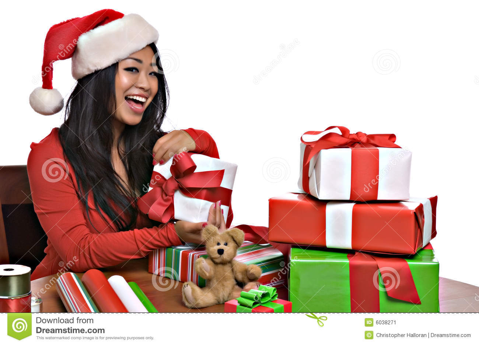 Beautiful Asian woman wraps Christmas presents