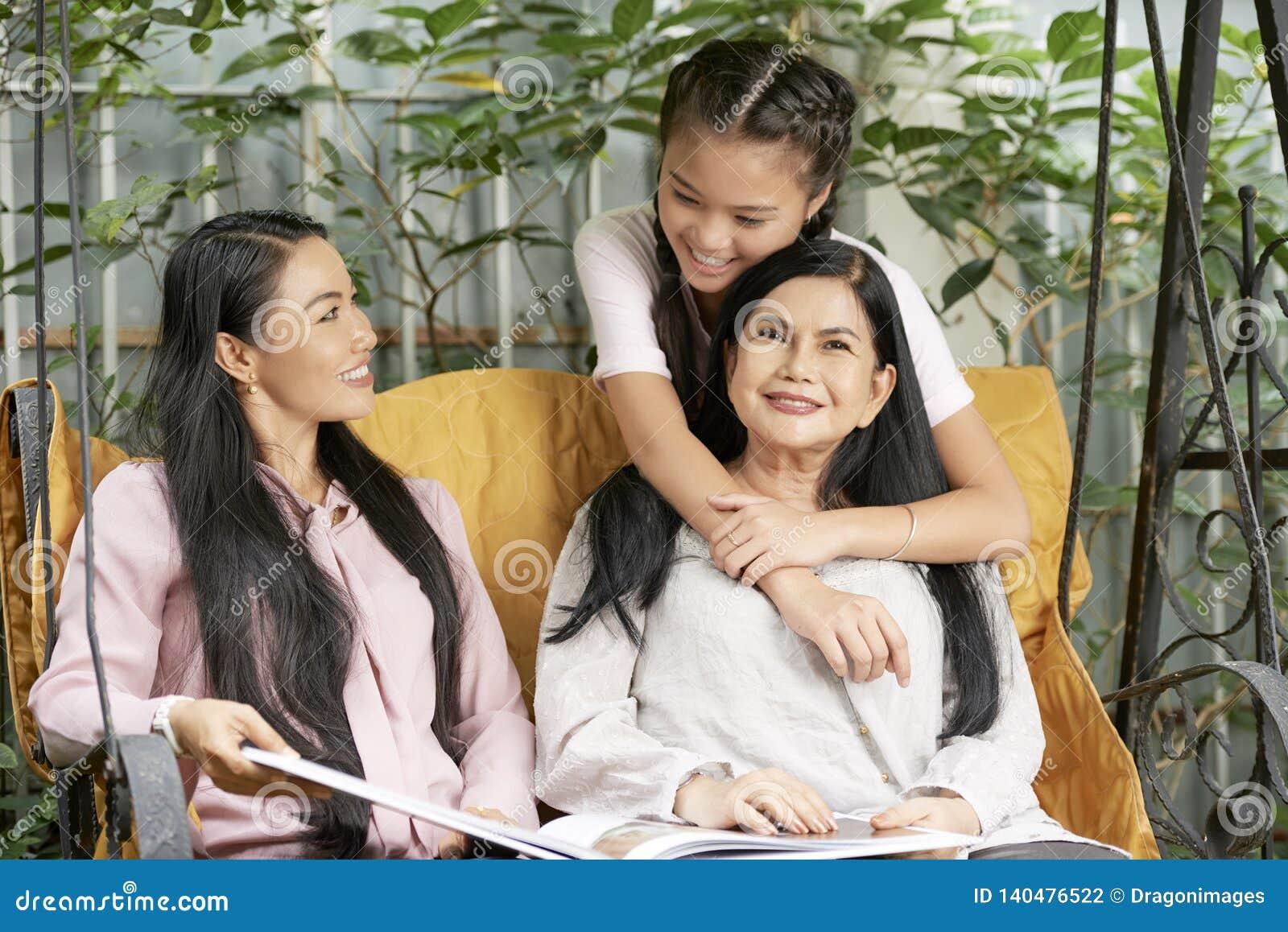Loving multi-generational women on swings