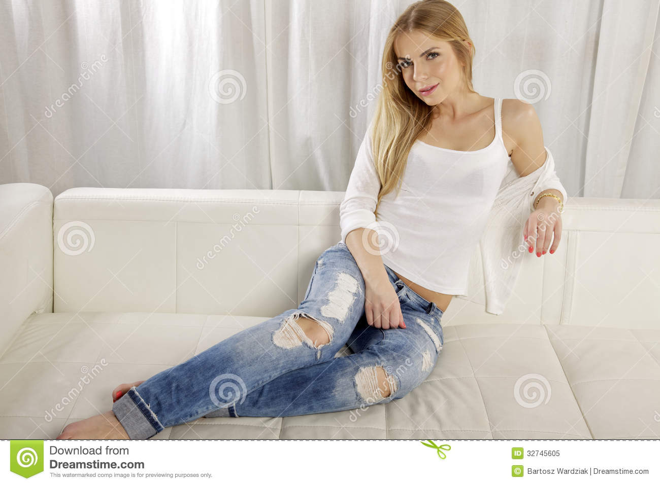 beautiful and attractive blonde woman posing in blue jeans