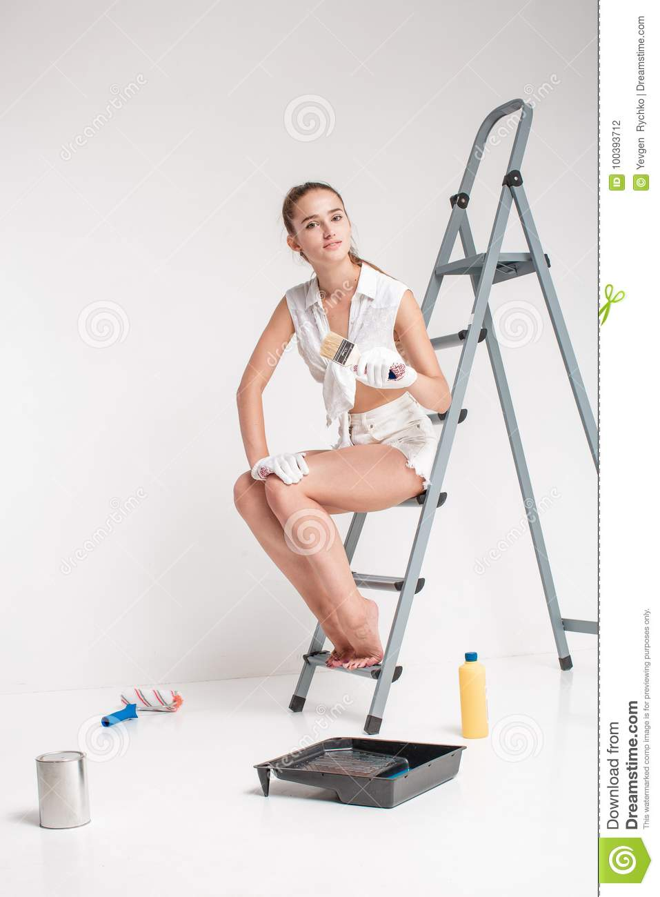 Woman Painting A Wall In House Stock Image - Image of