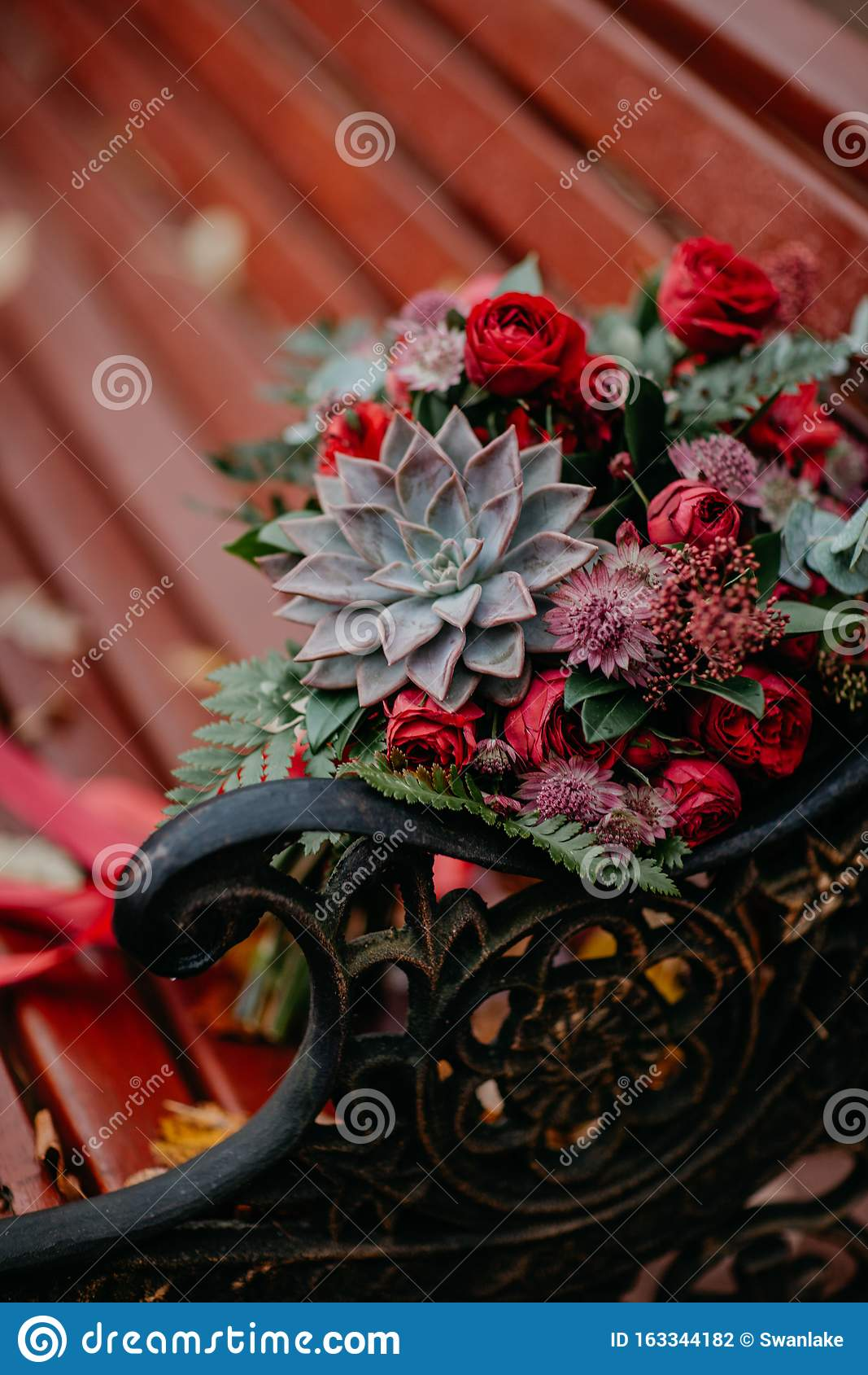 Beautiful Autumn Bouquet With Red Flowers And Succulents On A Bench Outside Stock Photo Image Of Colorful Bright 163344182