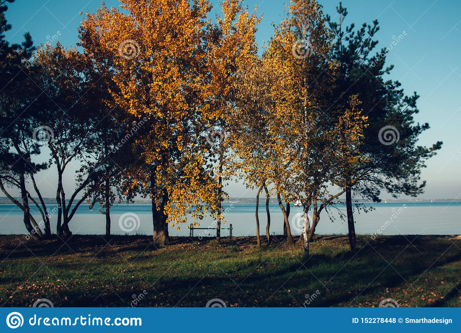 Beautiful autumn lake landscape and sunset. Blue waves and horizon line on water. Beautiful nature background
