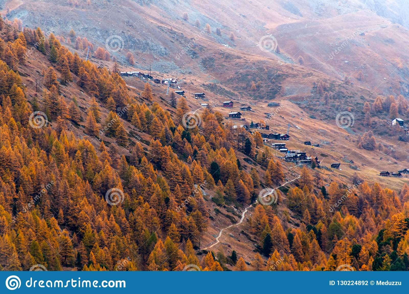 Beautiful autumn landscape with many old chalets in Zermatt area