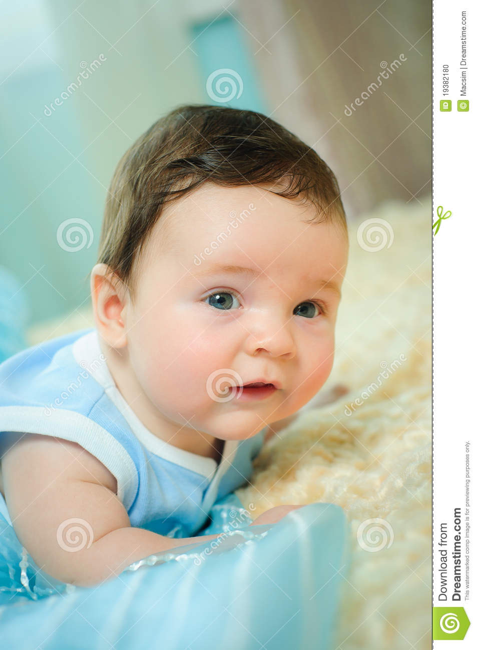 Beautiful Baby Boy Is Lying In A Bed Stock Photo Image
