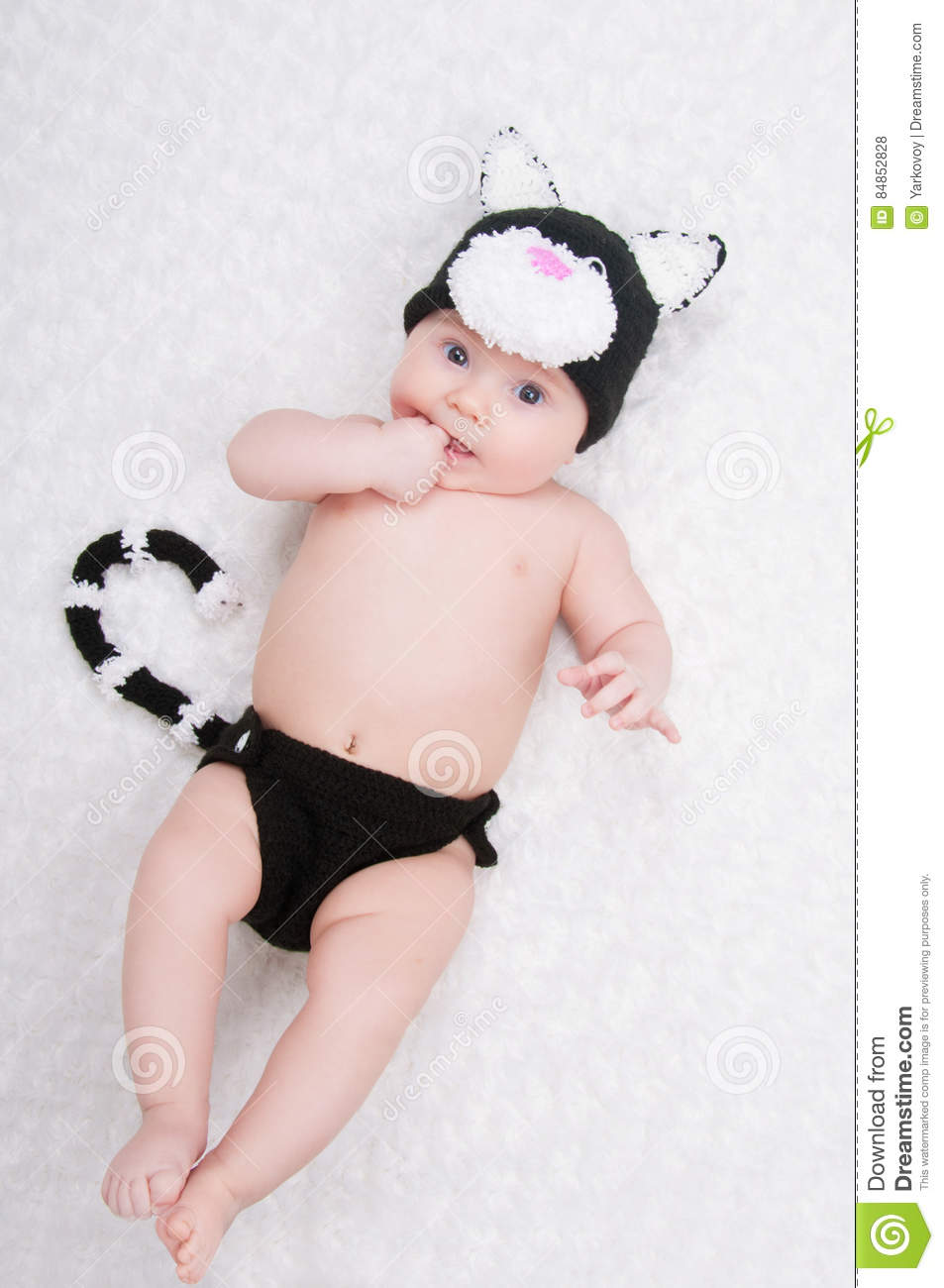 Beautiful baby in funny costume with cat ears and a tail.