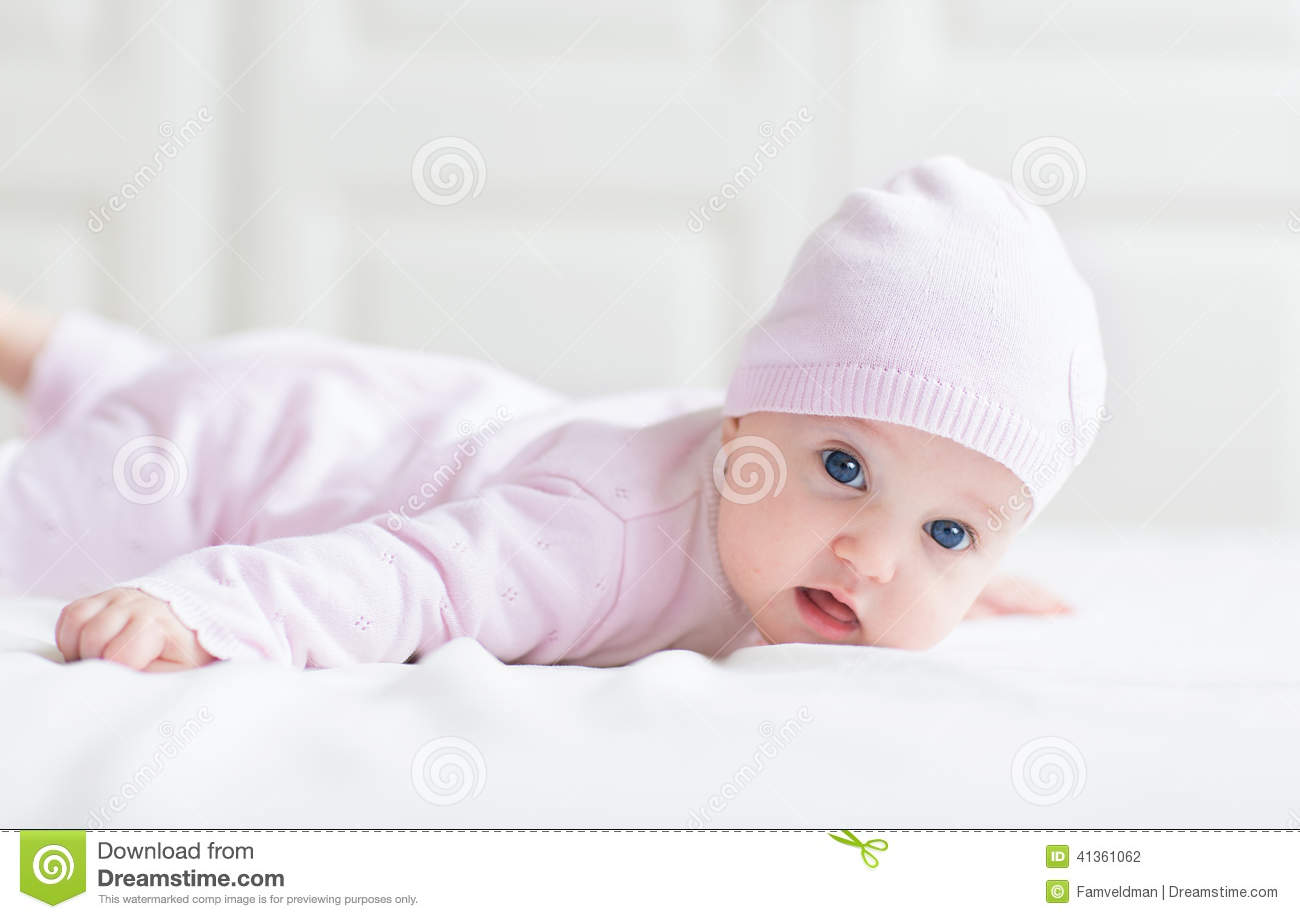 Beautiful Baby Girl With Big Blue Eyes In Pink Kni Stock