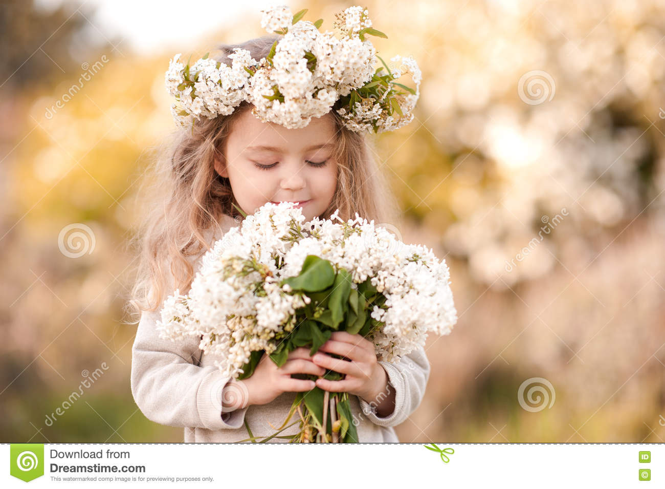 beautiful baby girl with flowers outdoors stock photo - image of