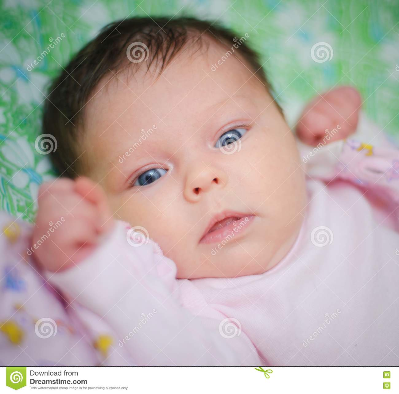 Beautiful Baby Girl Is Lying In A Bed. Royalty Free Stock Images ...