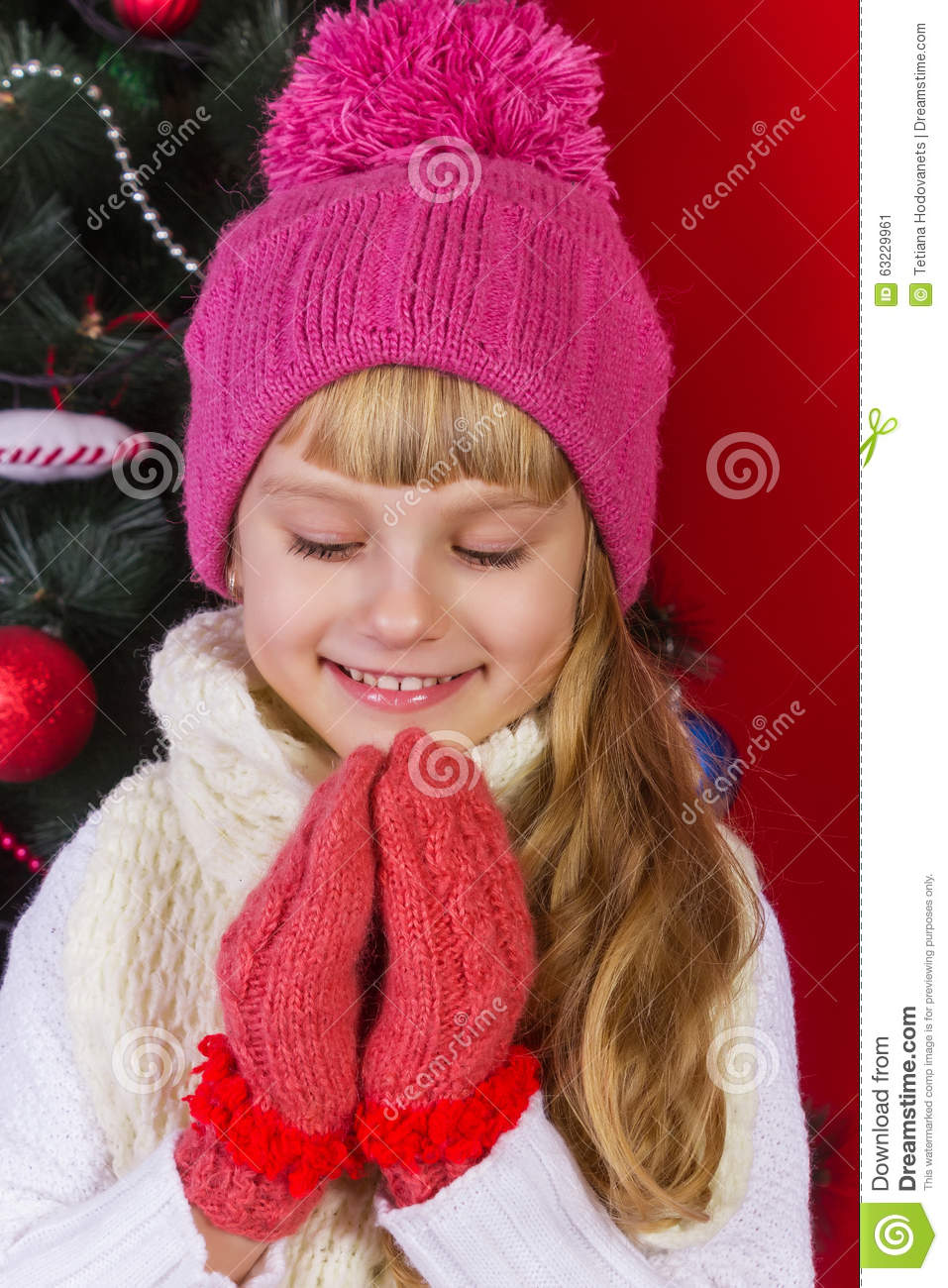 Beautiful Baby Girl In A Pink Hat And Gloves In New Year's ...