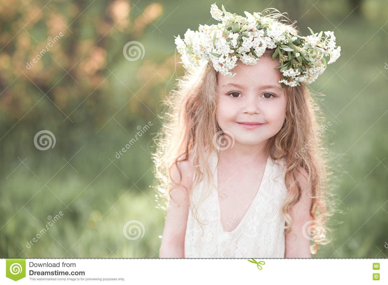 Beautiful baby girl posing outdoors over nature background