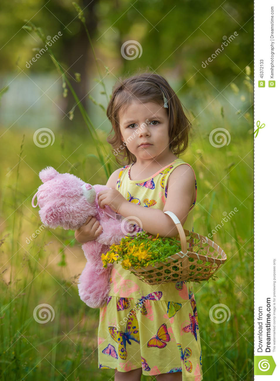 Beautiful Baby Girl Walking In A Sunny Garden With A ...