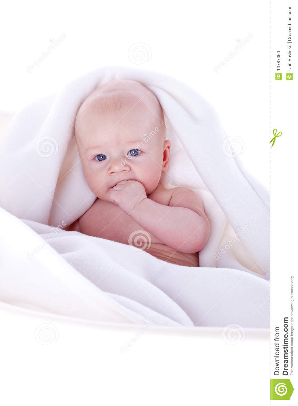 A Beautiful Baby Under A White Towel Stock Photo