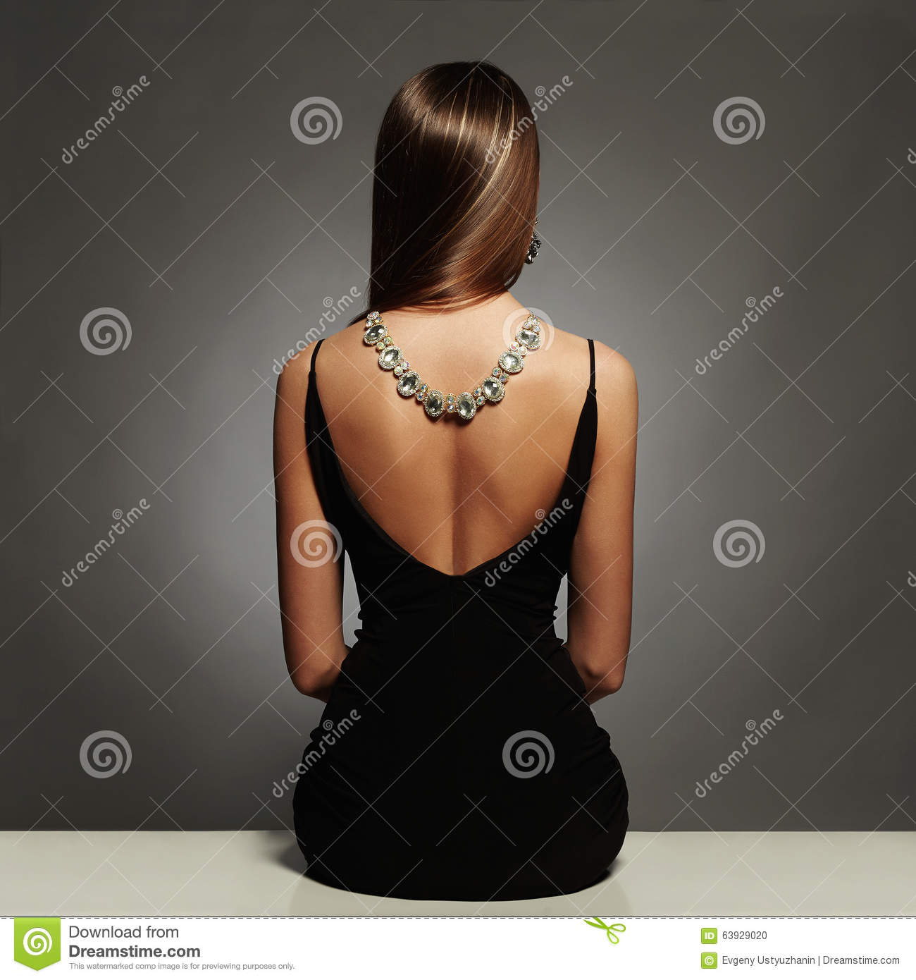 Download Beautiful Back Of Young Woman In A Black Dress. Luxury. Beauty Brunette Sitting Girl Girl With A Necklace On Her Back Stock Photo - Image of elegant, desire: 63929020