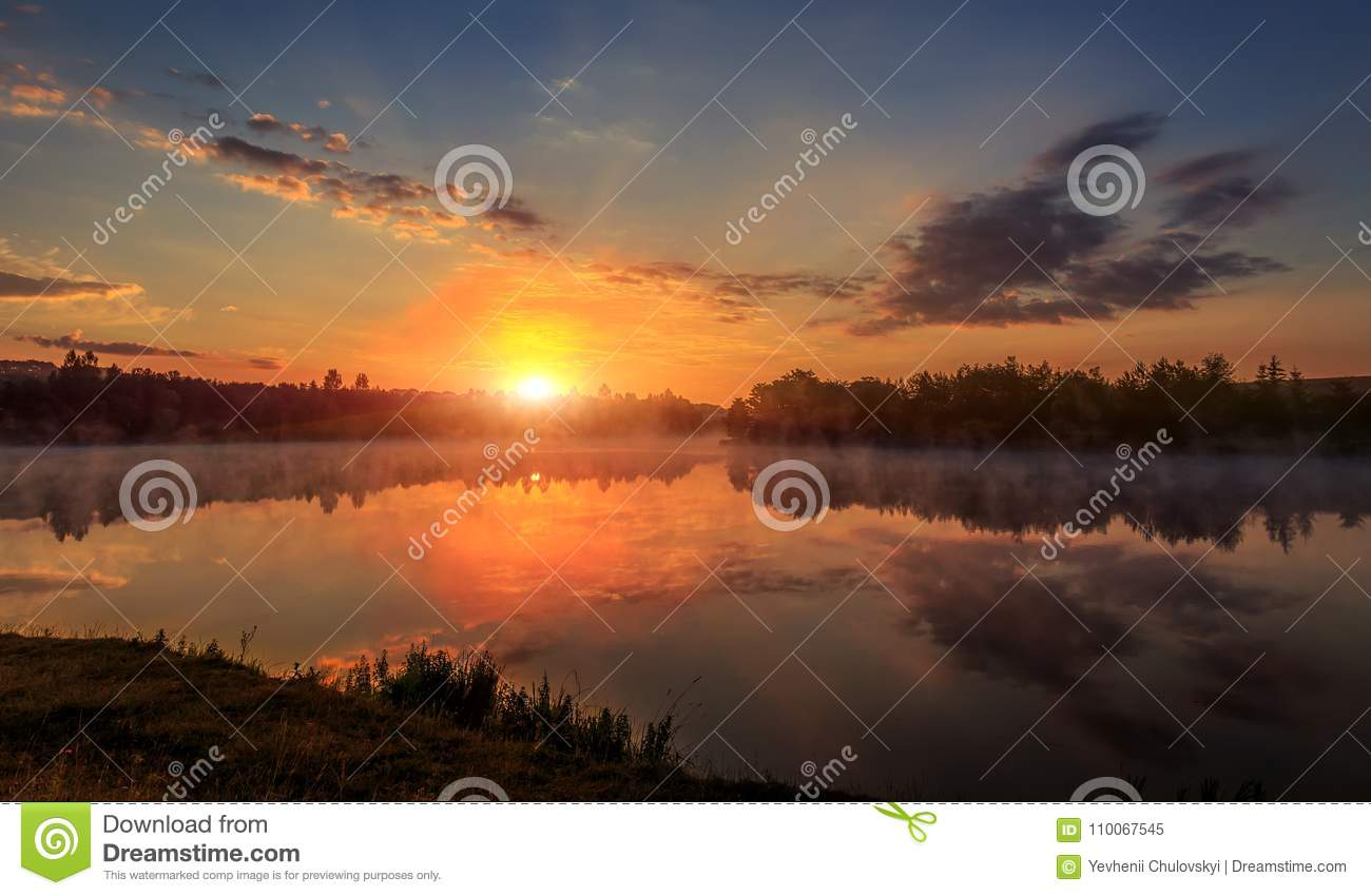 Beautiful background of nature. wonderful misty landscape. amazing foggy morning, colorful sky reflected in the water of tranquil