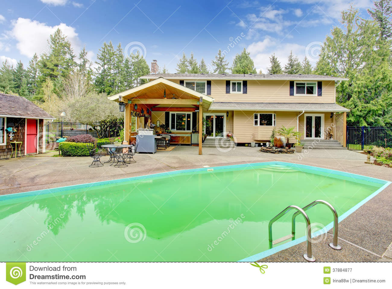 beautiful backyard with swimming pool and patio area royalty free
