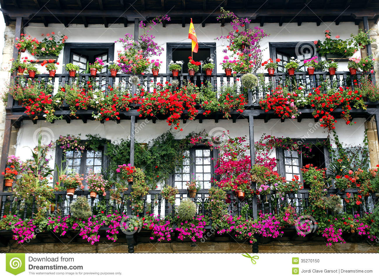 Beautiful balcony with flowers stock photo image 35270150 for Classic house with flower garden