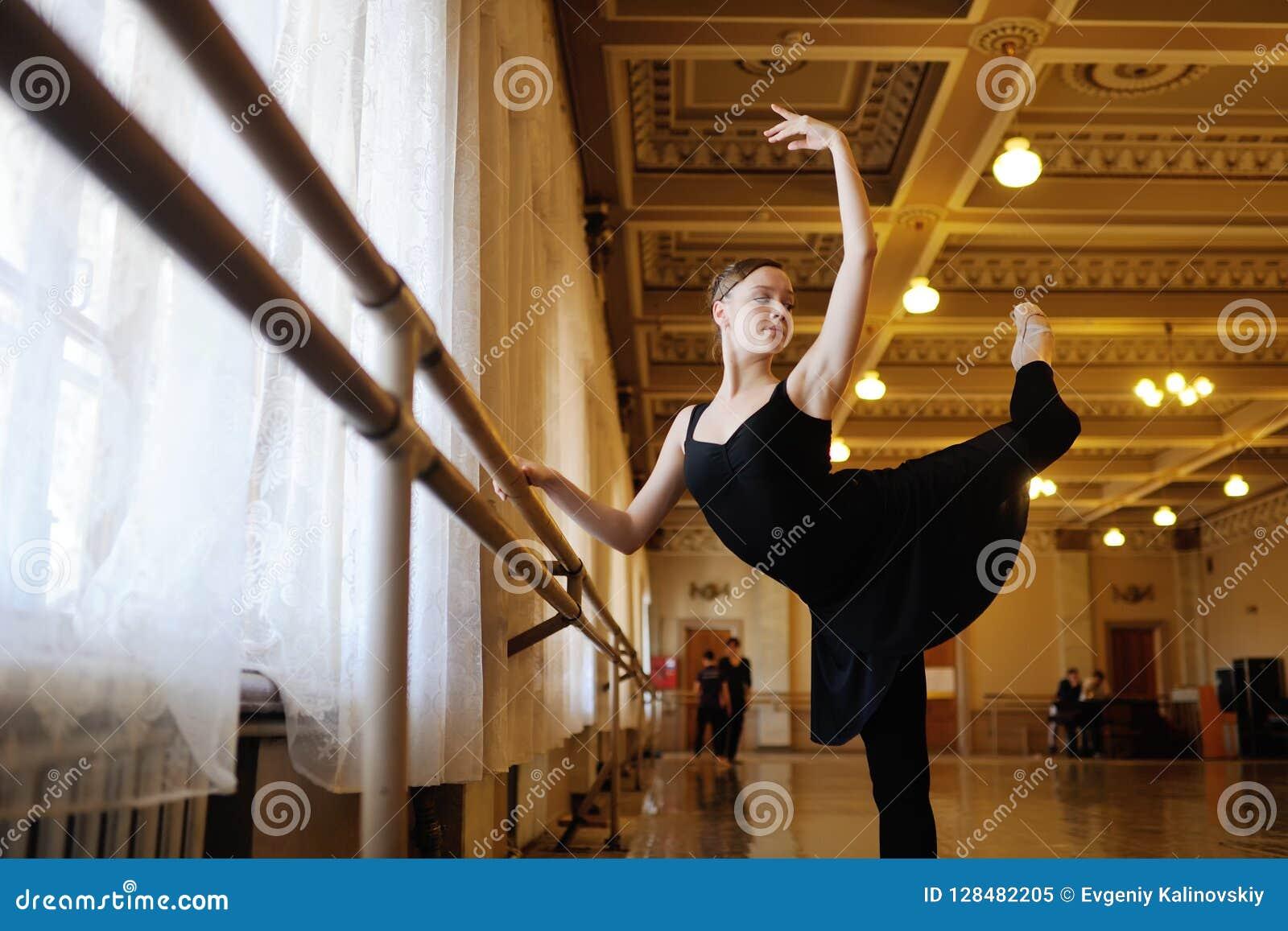 Ballerina in rehearsal or training in ballet class
