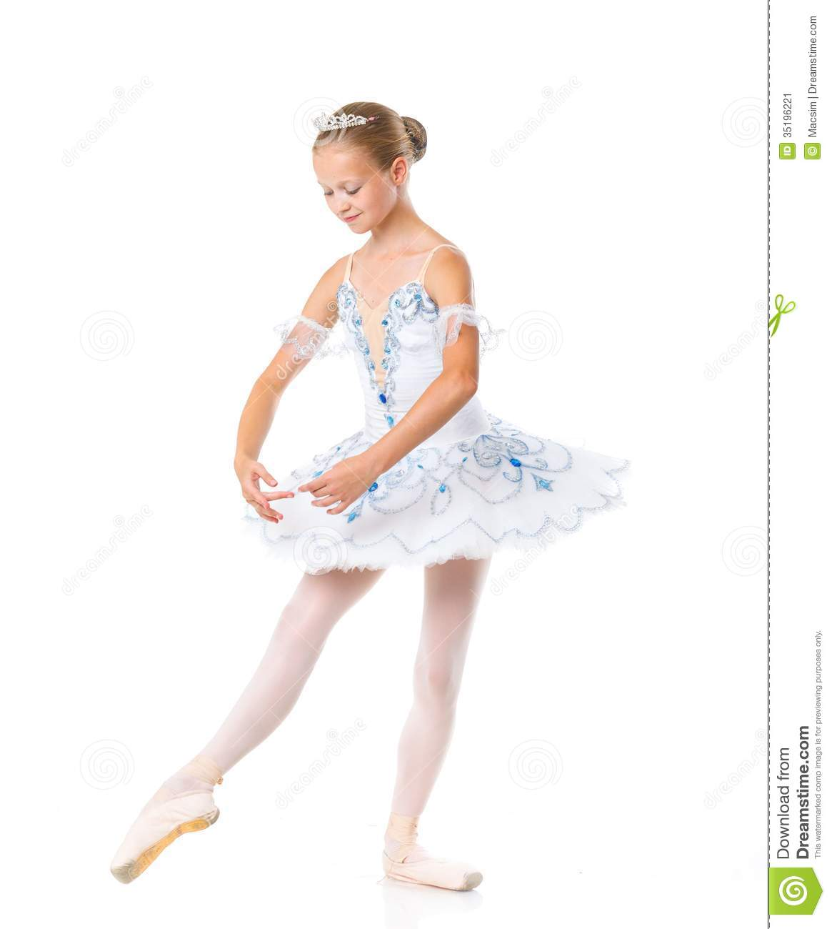 Beautiful young ballerina in classical tutu on a white background.