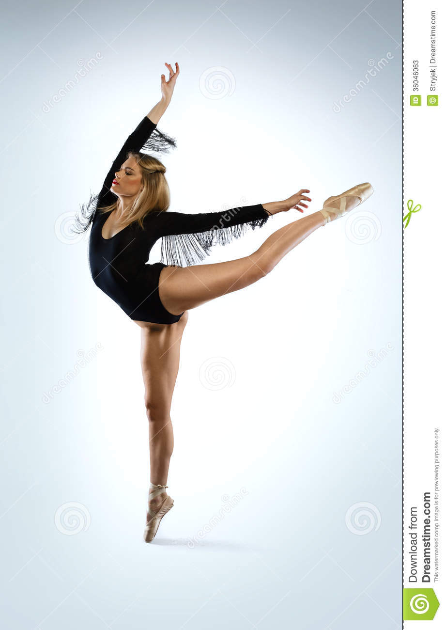 Beautiful graceful ballet dancer doing an arabesque en pointe with her ...