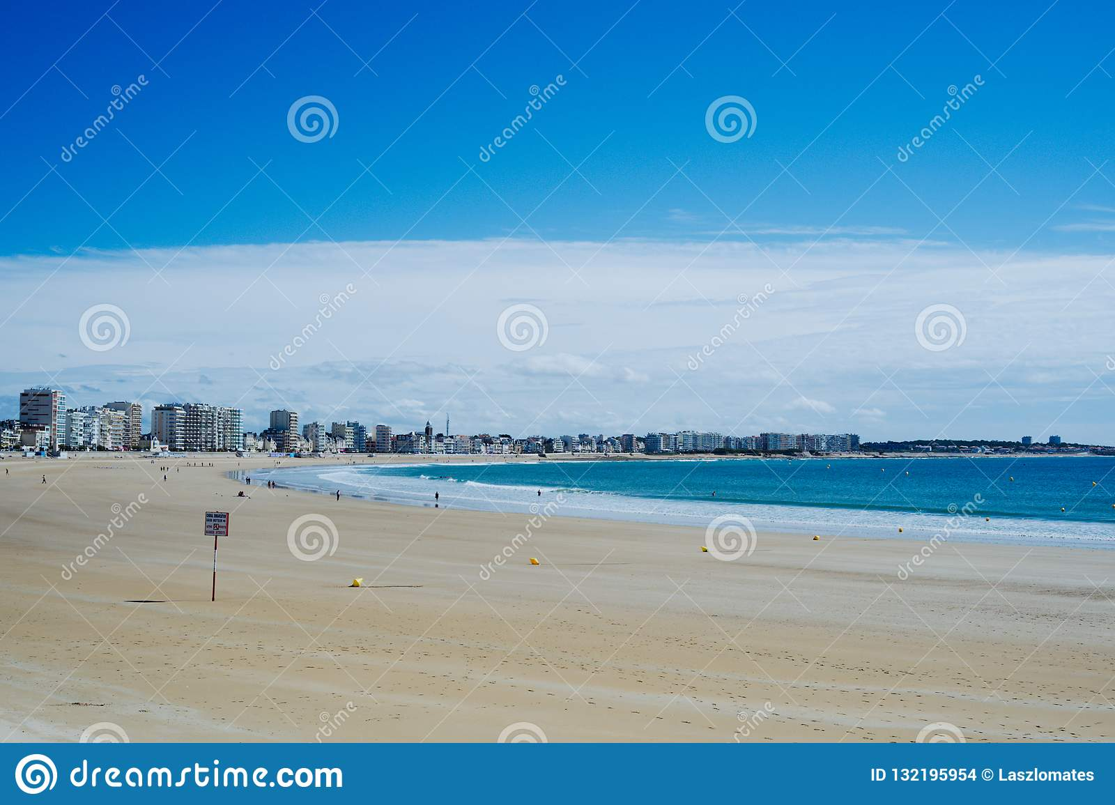 beautiful bay with a stunning blue sea white yellow sand and nice cityscape
