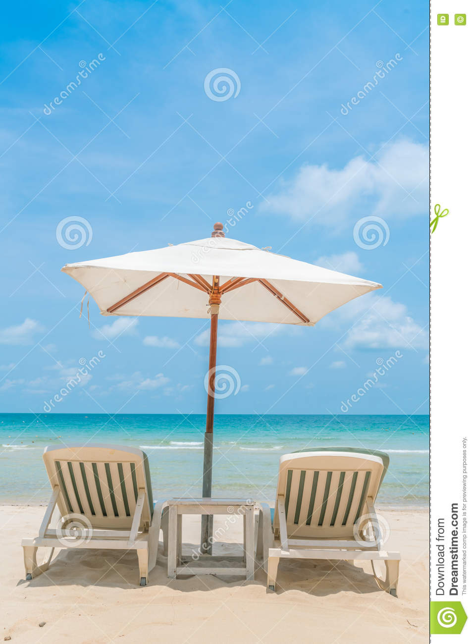 Beautiful Beach Chairs With Umbrella On Tropical White