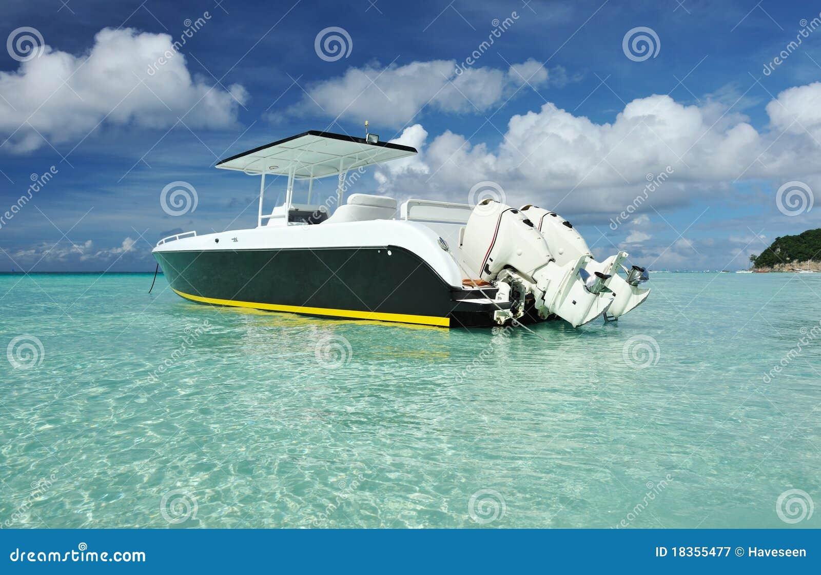 Beautiful beach with motor boat at boracay island philippines