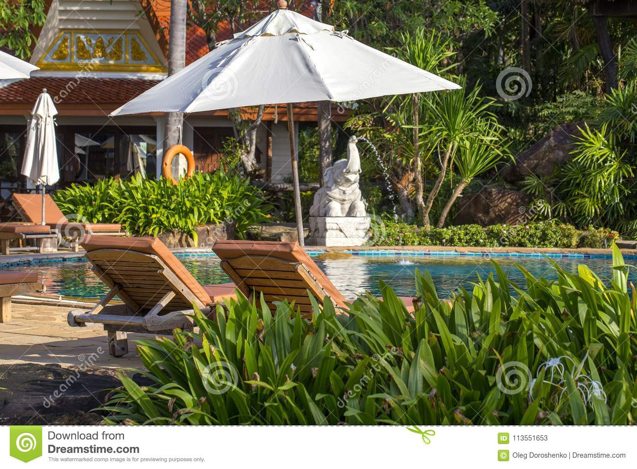 Beautiful Beach With Swimming Pool, Palm Trees, Daybeds And Umbrella ...