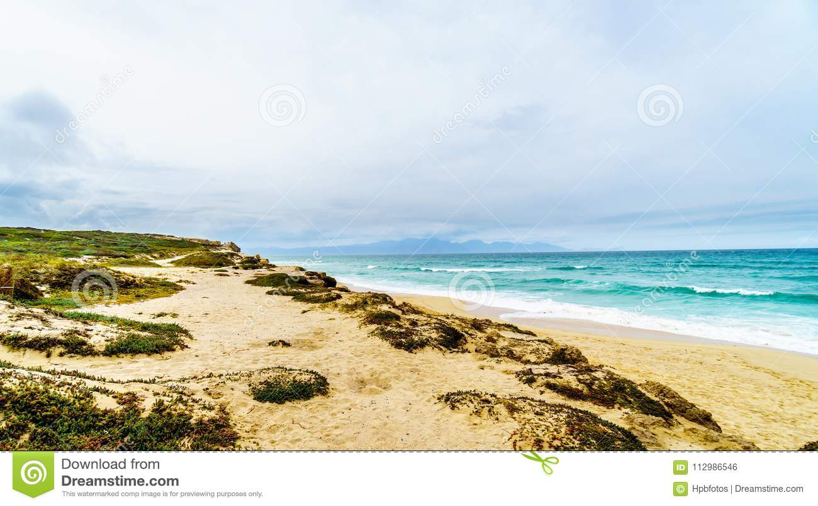 The beautiful beaches on False Bay along Baden Powell Drive between Macassar and Muizenberg near Cape Town