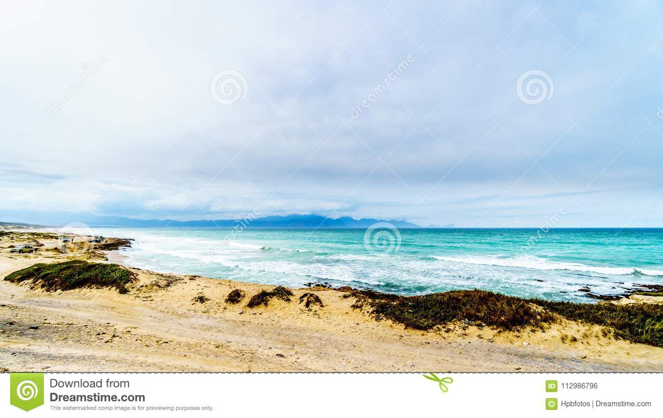 The beautiful beaches on False Bay along Baden Powell Drive between Macassar and Muizenberg near Cape Town
