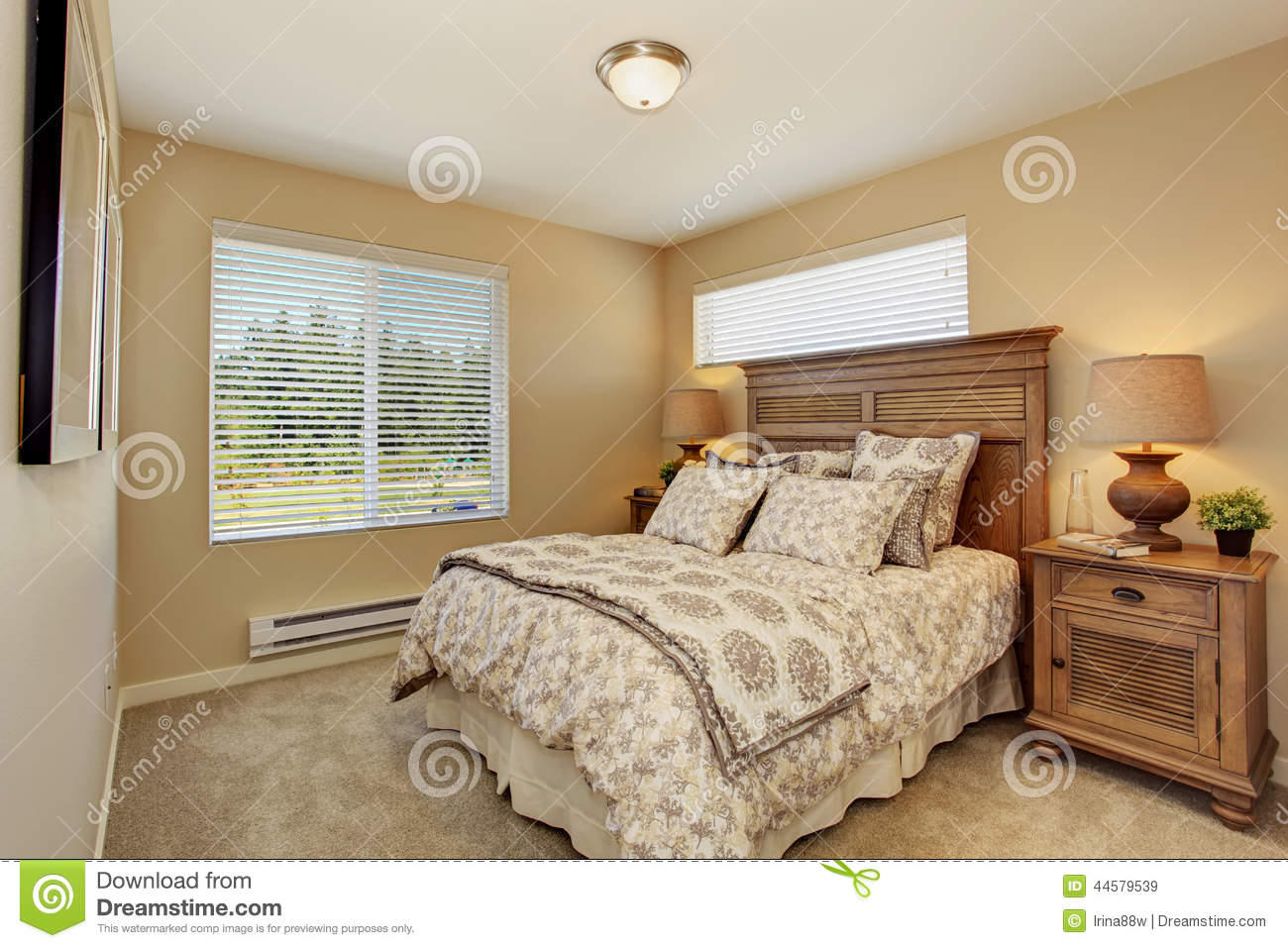 Beautiful bedroom with rich carved wood furniture stock - Beautiful bedroom photos ...