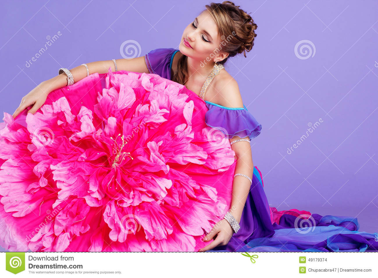faa855deda493 Beautiful belly dancer girl with nice makeup and heardress with pink flower  umbrella. Isolated on purple