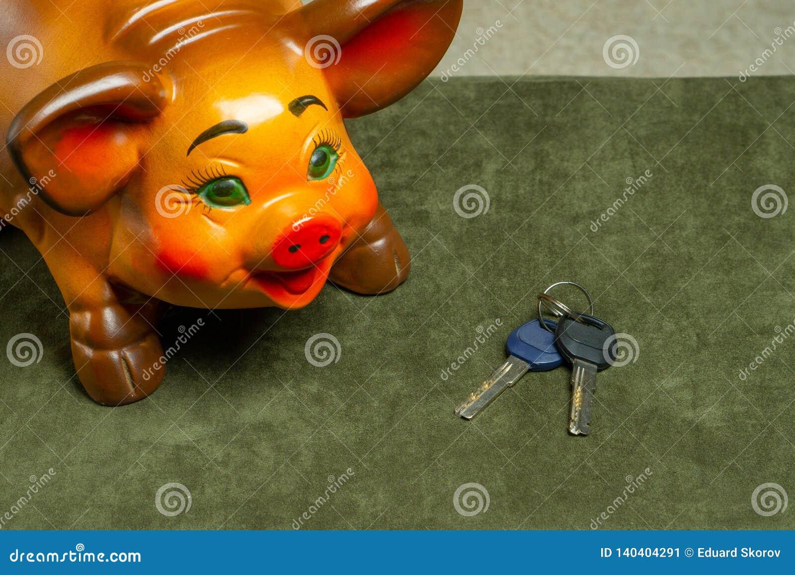 Beautiful big piggy bank and car keys. Clouse-up