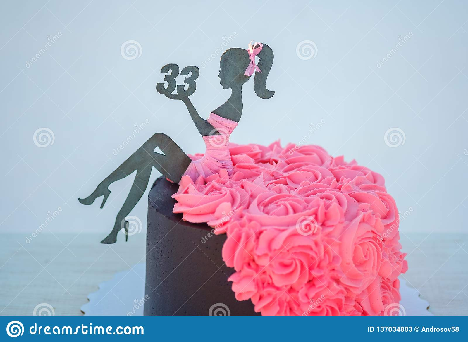 Beautiful Birthday Cake With A Figure Of Woman And The Number Thirty Three