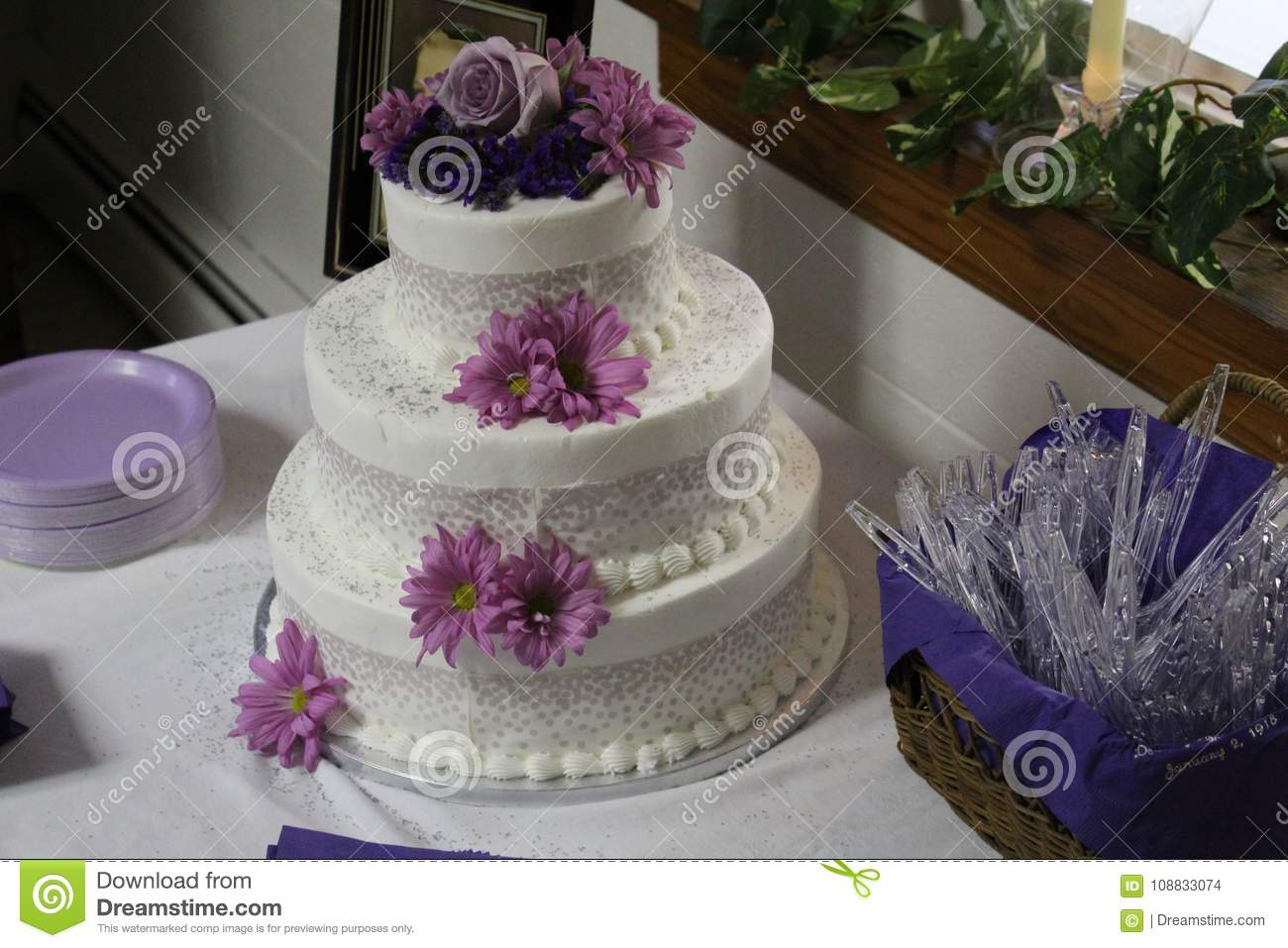 A Beautiful Birthday Cake Decorated With Flowers And Perfectly In Focus