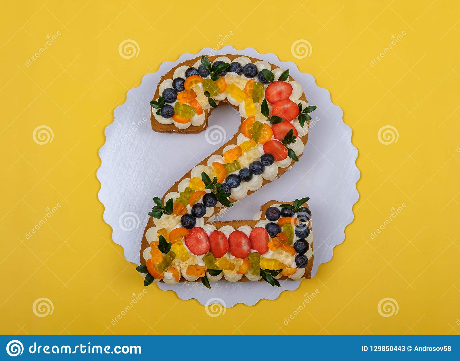 Beautiful Birthday Cake In The Form Of Numbers Two On A Yellow Background