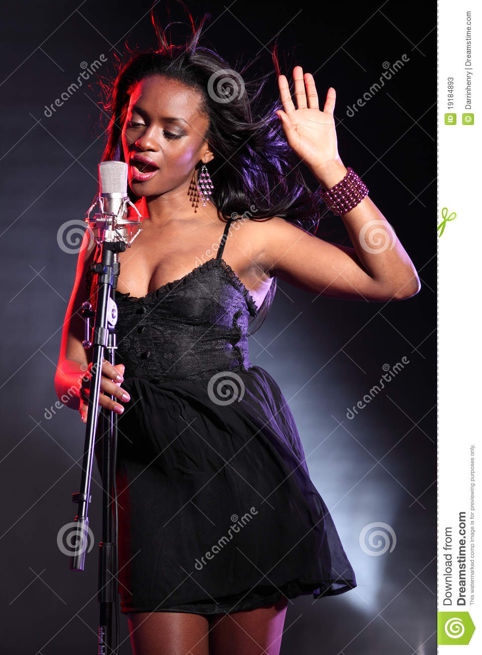 Beautiful Black Singer On Stage With Microphone Stock ...