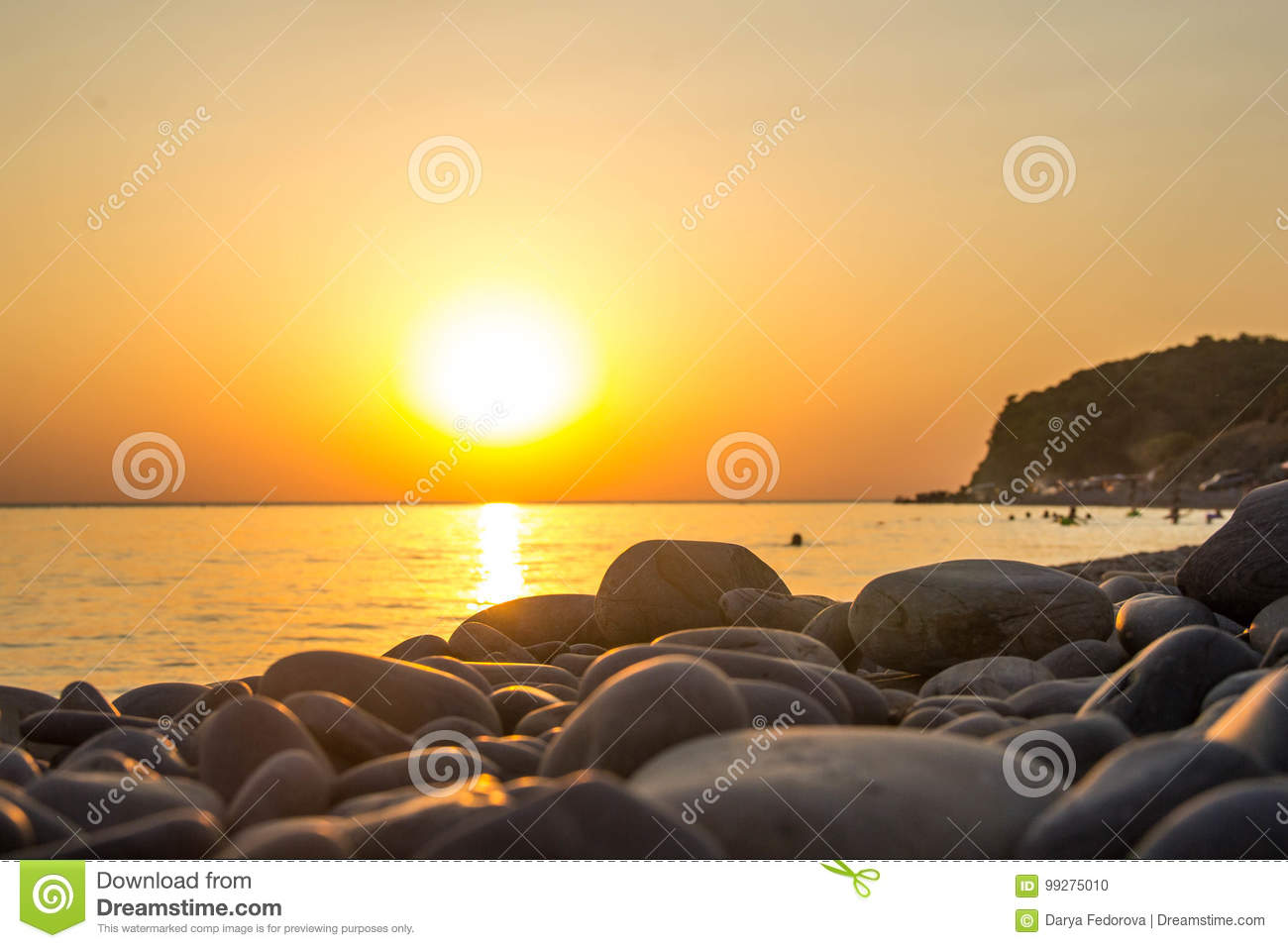 Beautiful blazing sunset landscape at black sea and orange sky above it as a background