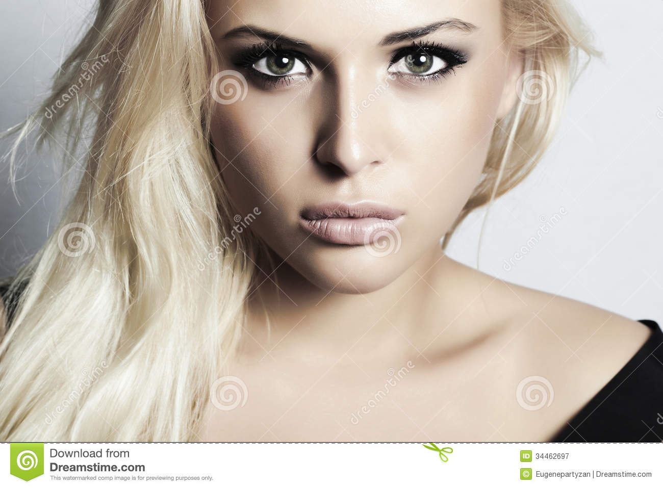 Beautiful blond girl with green eyes. woman. professional make-up