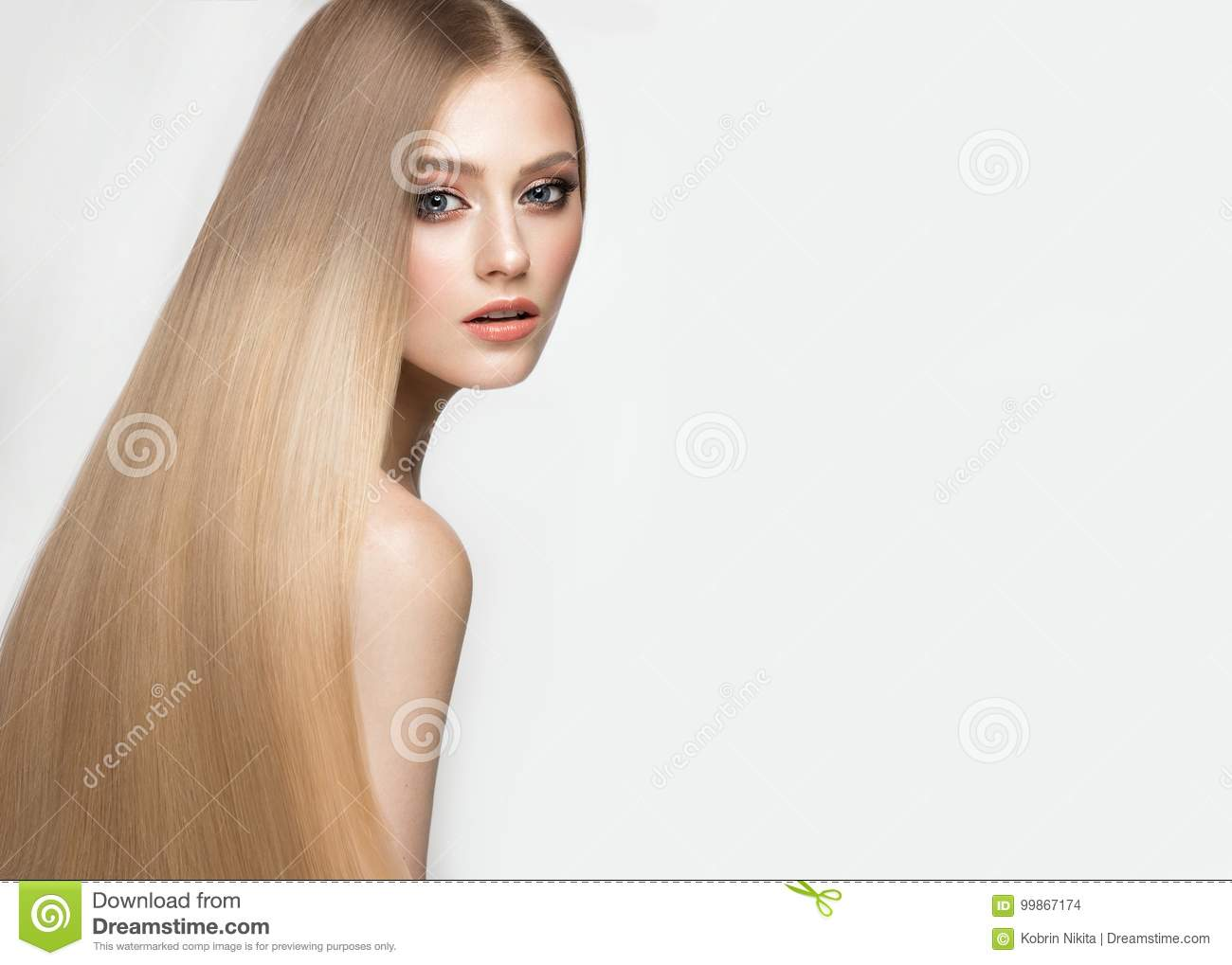 Beautiful blond girl with a perfectly smooth hair, and classic make-up. Beauty face.