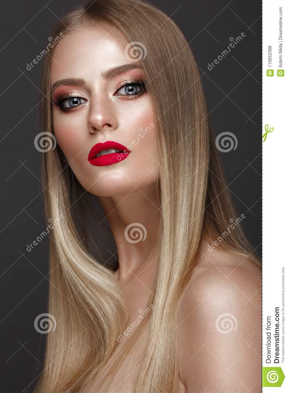 Beautiful blond girl with a perfectly smooth hair, classic make-up and red lips. Beauty face