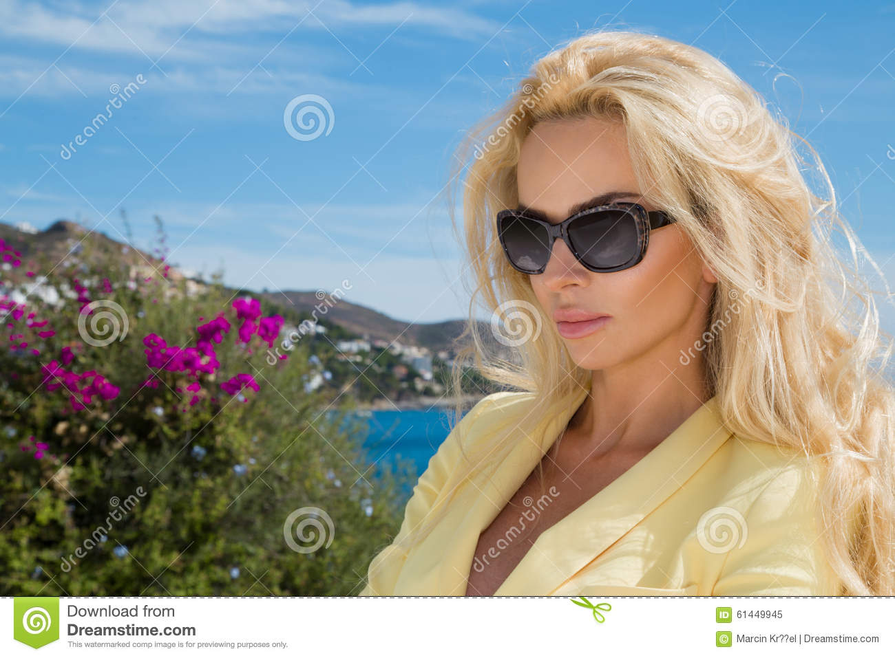 Beautiful blond hair woman young girl model in sunglasses in yellow dress, elegant jacket