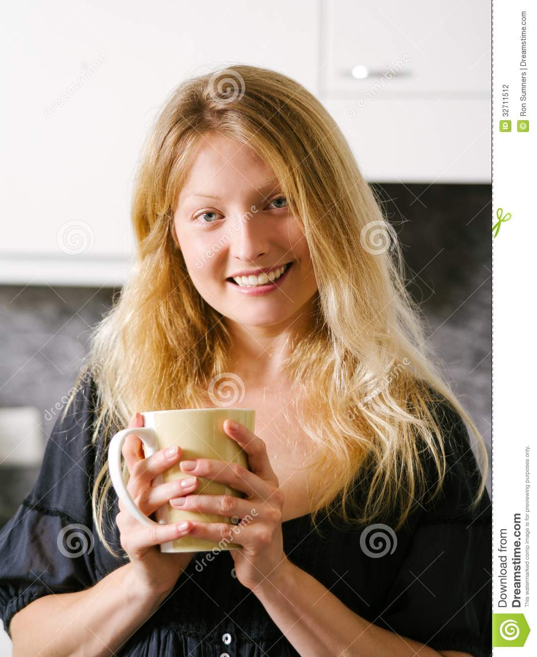 Beautiful blond holding a large coffee