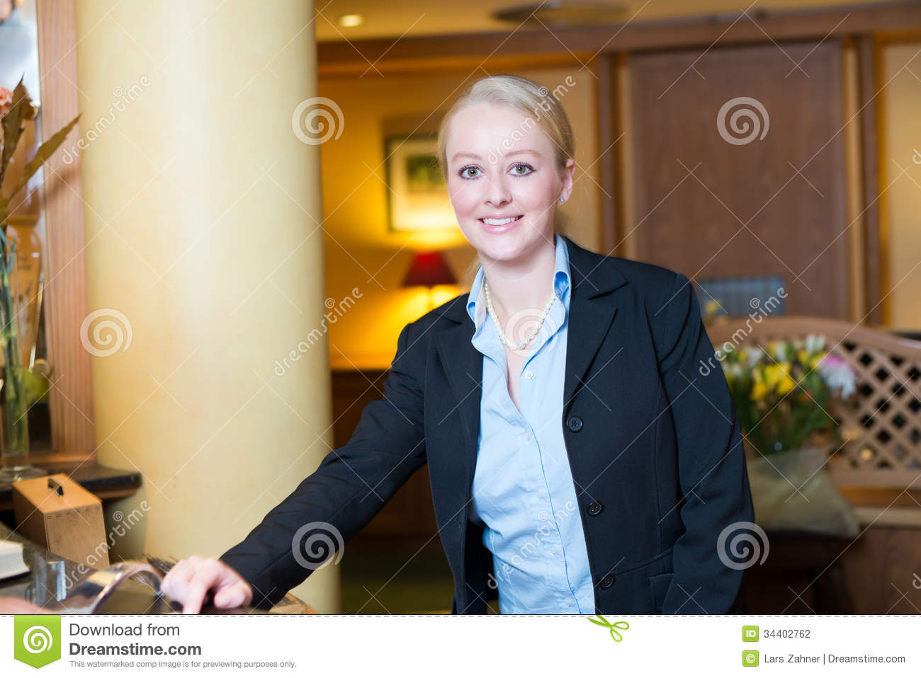 Beautiful Blond Hotel Receptionist Stock Photo - Image ...