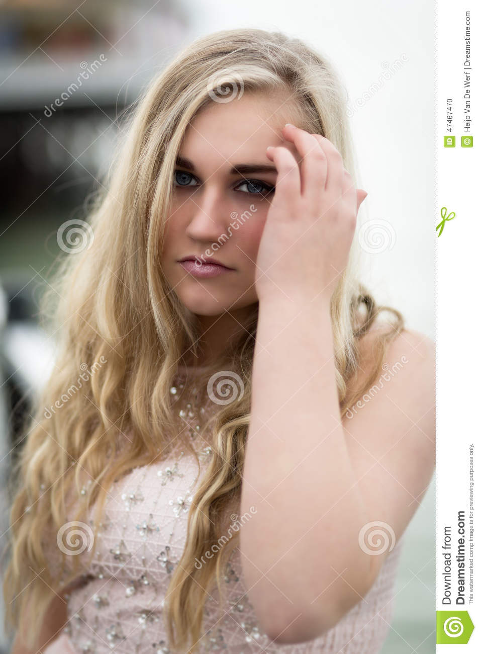 Beautiful Blond Teenage Girl With Blue Eyes