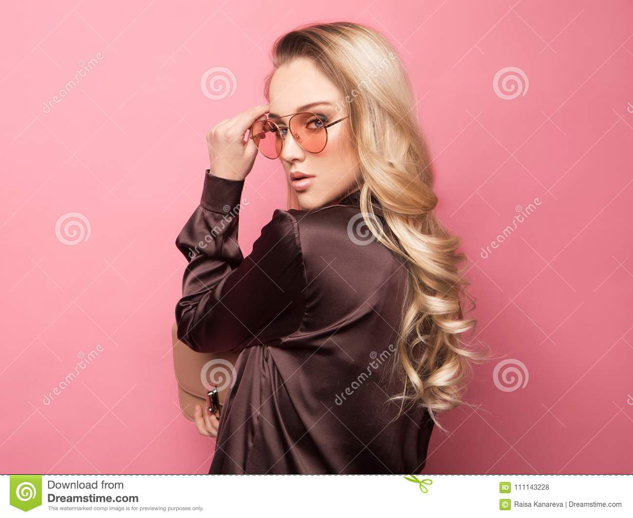c094273c05b00 Beautiful Blond Woman In A Blouse And Pants Wearing Glasses