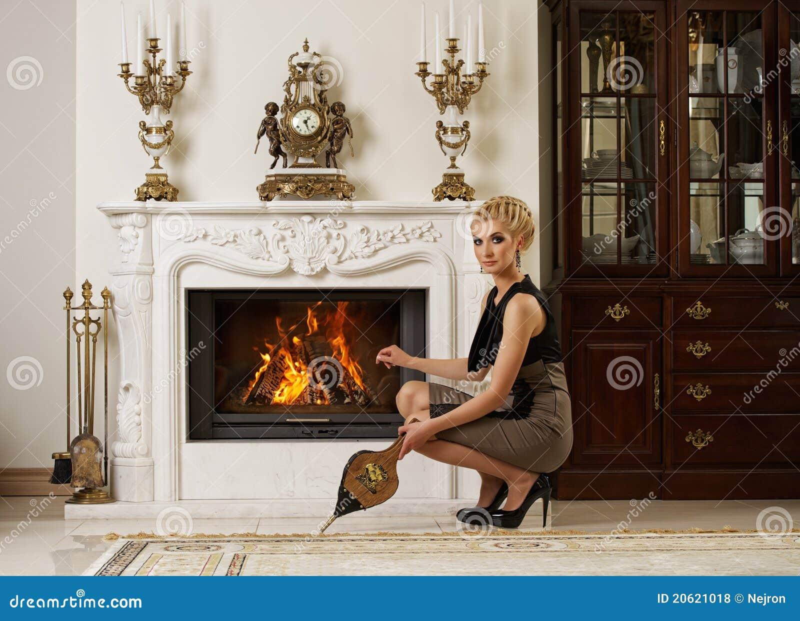 Beautiful Fireplace beautiful blond woman near the fireplace stock image - image: 20621011