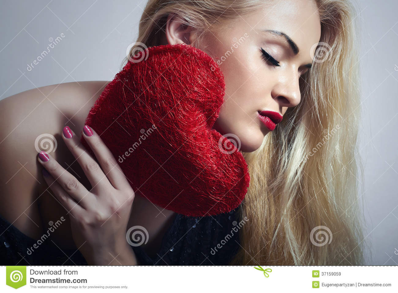 Beautiful Blond Woman with Red Heart. Beauty Girl. Show Love Symbol. Valentines Day