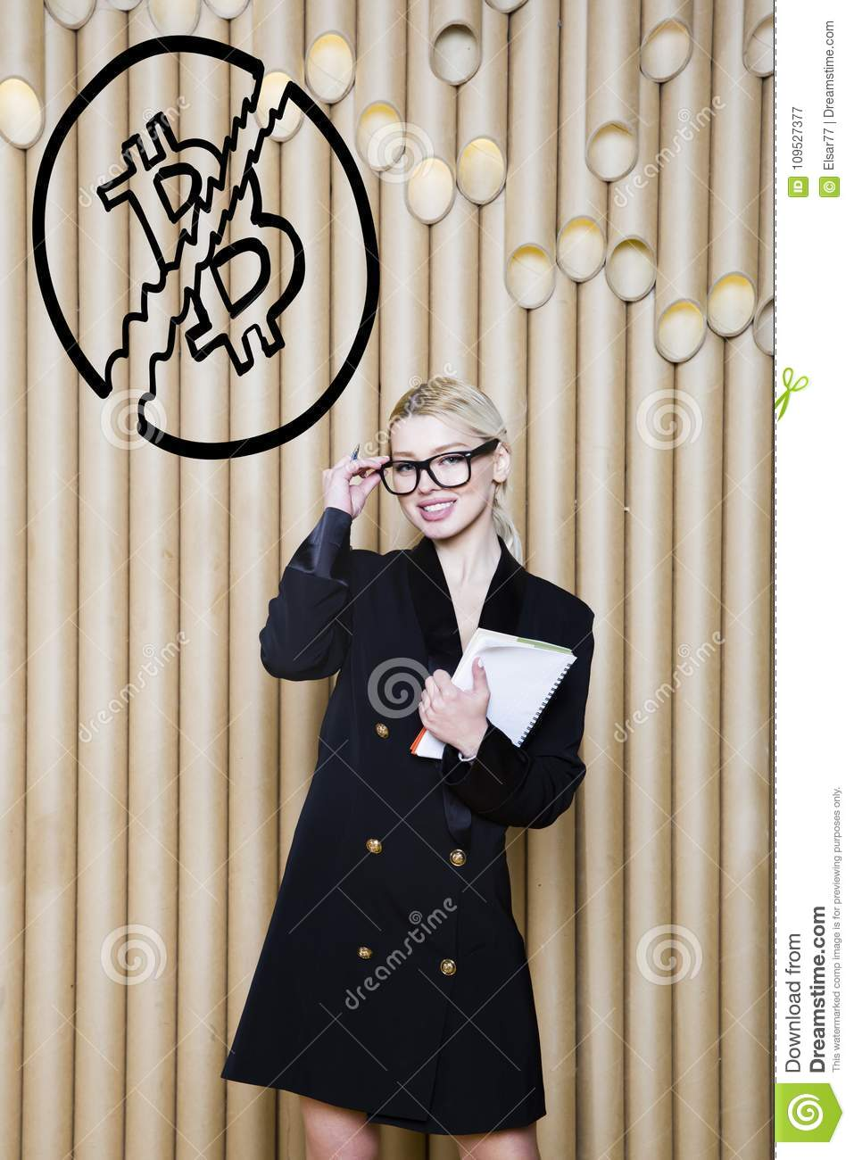 Beautiful blond woman showing standing near bitcoin sketch. Virtual money or btc crush concept. Cryptocurrency.